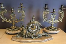Clock and pair of candelabra in bronze, 20th century