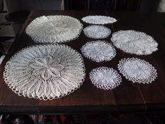 Lot of eight doilies of art garments.