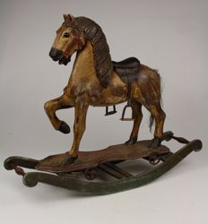 Solid wooden hand-carved rocking horse with leather saddle
