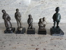 Five unique, well-known bronze plated local figurines on marble pedestals, from Netherlands
