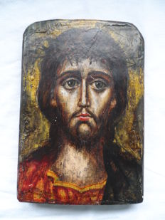hand painted icon on wood - image of Jesus - made around 1900.