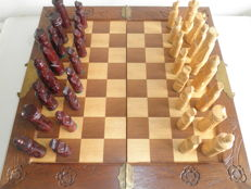 Hand-carved wooden chess set in chest