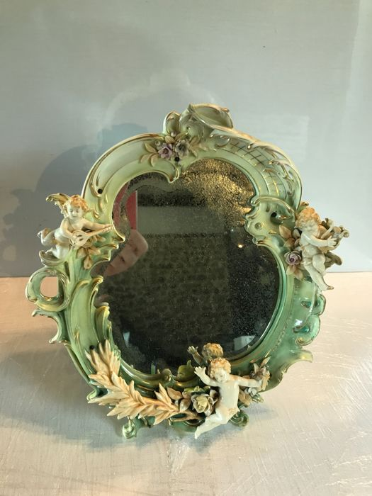 German porcelain mirror with decoration of flowers and angels - 19th century