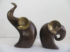Abstractly designed bronze elephants