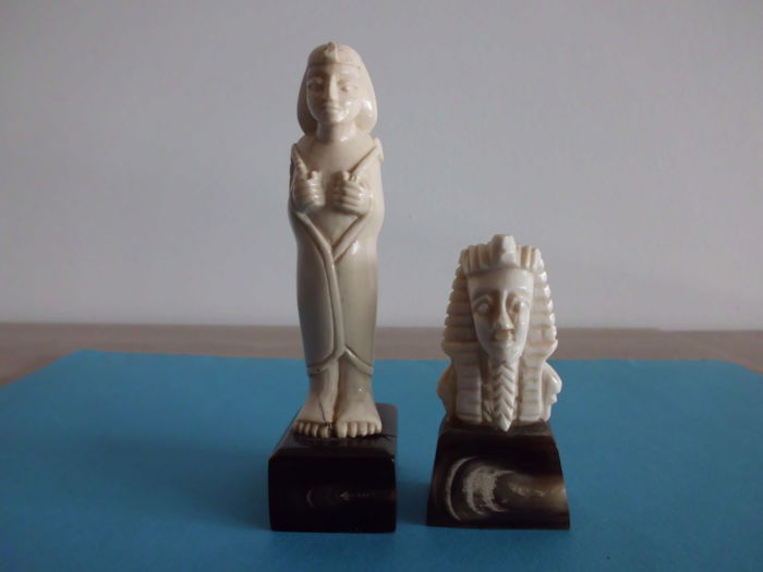 Egypt - two ivory figurines - Tutankhamun 1920 and concubine Kiya 1930 - with valuation reports.