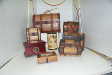 Collection of 8 boxes of various sizes and materials