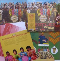 Sgt. Pepper Lonely Hearts Club Band Anniversary Edition double album with new stereo mix plus posters inner sleeve etc. combined with a original 1969 NL copy