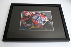 Professionally framed image, personally signed by Andrea Dovizioso