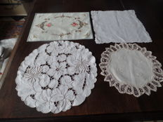 Land of four square hand - embroidered doilies.