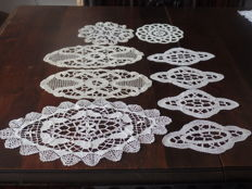 Lot of nine bobbin lace doilies.