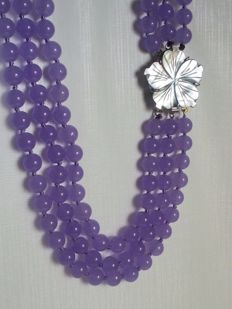 Three-strand necklace made of lavender jade with mother of pearl clasp.