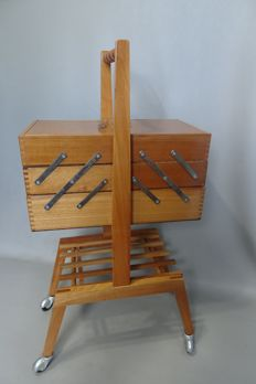 Wooden sewing box on wheels