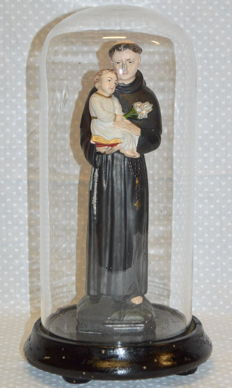 "Antique blown glass case with painted ebony wood base, containing a hand-painted plaster sculpture of ""Saint Anthony of Padua"" holding Jesus"