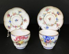 Vincennes, pair of porcelain cups with saucer, with polychrome decoration with flowers and a pink and blue ribbon.