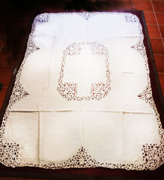 Large tablecloth embroidered by hand with Richelieu embroidery.