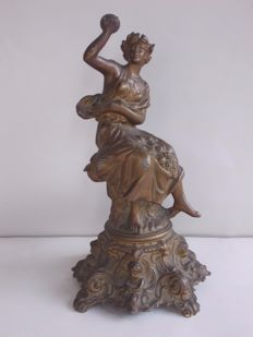Large-sized antique sculpture, depicting a lady sitting on a throne with relief Cherub faces on the base - France - ca. 1900