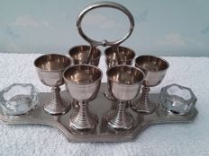 silver plated egg cups with salt vases and holder, England