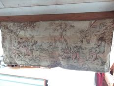 Large tapestry of a medieval scene.