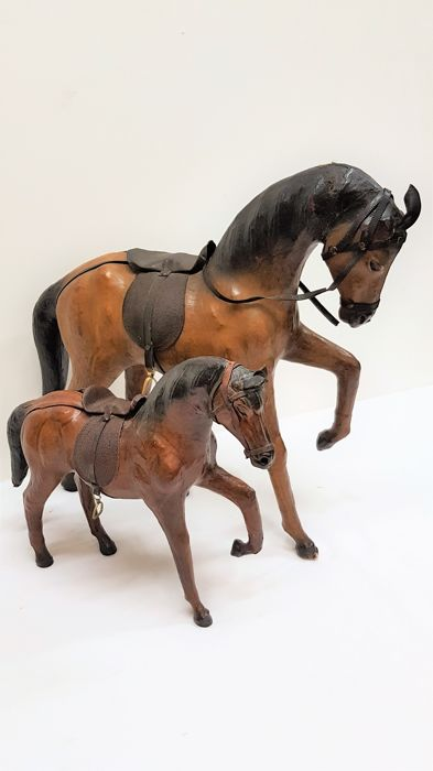 Two ornate leather horses