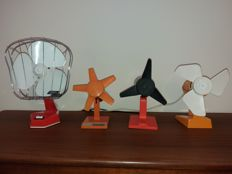 Four plastic fans from the 60/70sin orange, yellow, red, white.