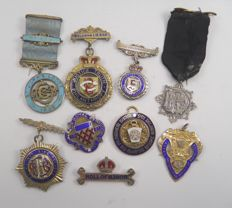 Collection of 9 .925 sterling silver & enamel Masonic & Buffalo medals & Jewels