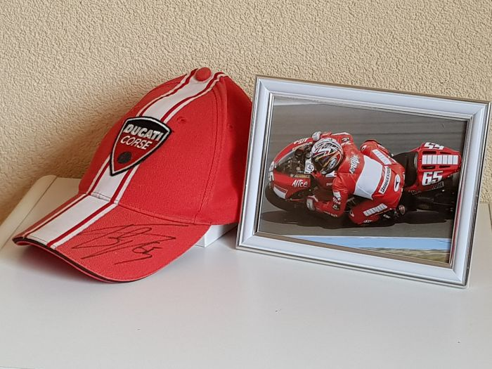 Loris Capirossi - Multiple Worldchampion - hand signed Ducati Cap  + framed photo + COA.