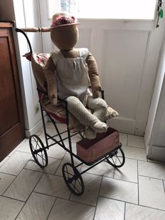 Child mannequin with stroller and a canvas oil painting of a little girl, first half of the 20th century, France