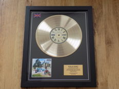 """Oasis """" Be Here Now """" LP gold disc."""