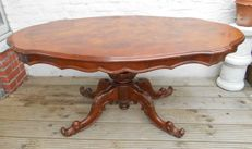 Walnut and burr coffee table with carved trestle - France - first half of 20th century