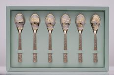 Spoons of stainless with a titanium coating with pictures of Little Dog, Little Cat, Bunny, Elephant, Little Bird, Hedgehog