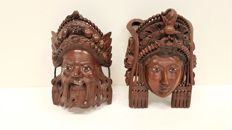 Masks with woodcarving, man/woman - Indonesia - late 20th century