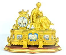 Mantel clock on stand with Sevres style porcelain decorations on the gilt wood base - Phillipe H. Mourey - France, late 19th C.