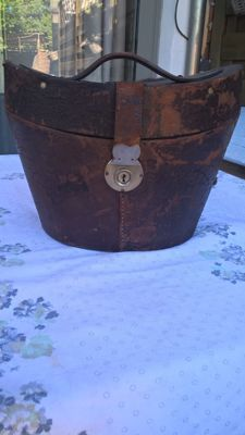 Late 19th century British leather hat box / velvet upholstery.