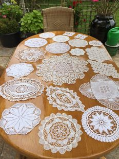 20 white hand crocheted cotton doilies.