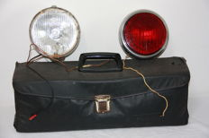 Vintage car tool bag from 1973, fog light white ZKW 1984 and red rear fog light Bosch vintage from 1976