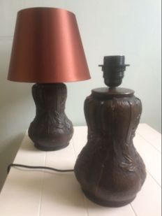 A pair of cast iron table lamps with floral motifs.