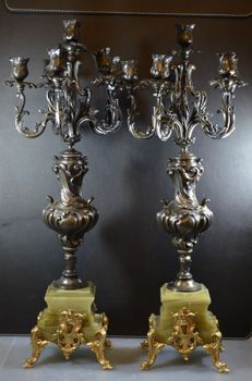 A few large bronze candlesticks on marble base finished with brass accents, first half 20th century