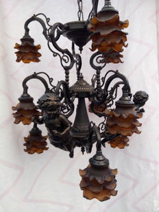 Chandelier decorated with angels and nine glass shades, 20th century.