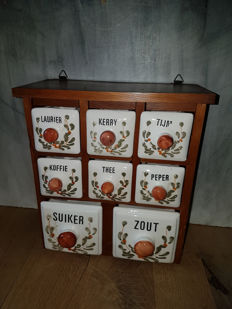 Herbs cabinet with hand painted porcelain dishes