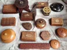 Nice collection of 15 hand-carved wooden boxes and 1 plants table.