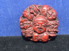 "A red lacquered "" Manju"" Netsuke – Japan – late 19th century"