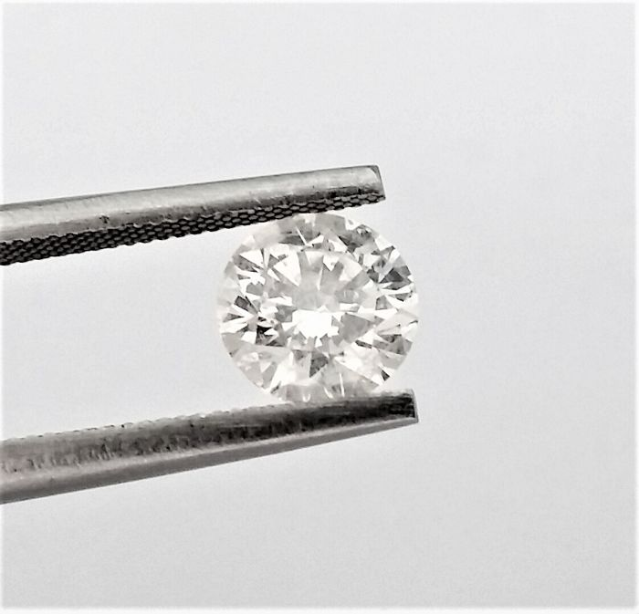 Round Brilliant Cut  - 1.12 carat  - G color  - SI3 clarity  - Natural Diamond  Comes With AIG Certificate + Laser Inscription On Girdle