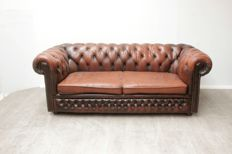 Padded brown leather Chesterfield sofa, England, Ca. 2000