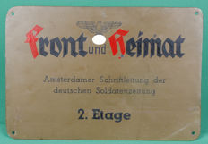 """a special wall sign """"front und heimat"""" (newspaper for the German soldier) Division Amsterdam, made of metal"""