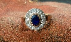 Fermale antique ring oval blue sapphire,and 10 brilliants