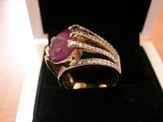 18 kt yellow gold ring  12.18 gr total with Ruby 7.43ct,  diamonds 0.65ct - ring size: 18.5 mm  whit IGI certificate  hand made never worn