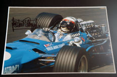 Nice framed image, personally signed by Jackie Stewart