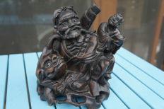 Statue of an immortal and a Foo dog - China - first half of the 20th century