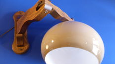 Retro 70's wall lamp. Wood and plastic.