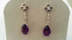 Earrings in 18 kt white gold with diamonds and amethysts